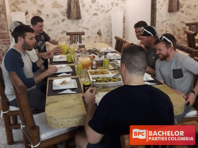 Cartagena Bachelor Party Group Having A Meal