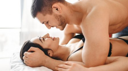 Games of intimate partners in bedroom, hot intimacy lovers. Passionate love couple, erotic in bed